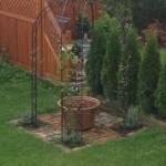 Gartenideen Gartenfläche mit Backsteinen verlegt